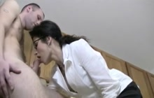 MILF with a ponytail and glasses sucking cock
