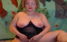 Grandmother with glasses teasing on cam