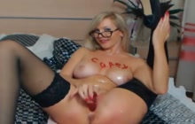 Glasses Wearing Blonde Hottie Plays With Pussy