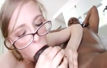 Nerdy girl with glasses sits on a BBC