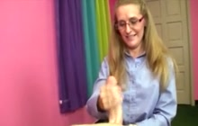 Mom with glasses on her knees to jerk off