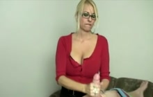 MILF with glasses strokes a hard dick