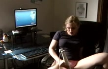 Horny blonde with glasses masturbates