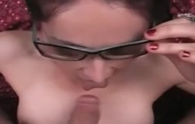 Nerdy chick blowing a cock