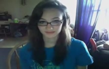 Adorable teen with glasses on web cam